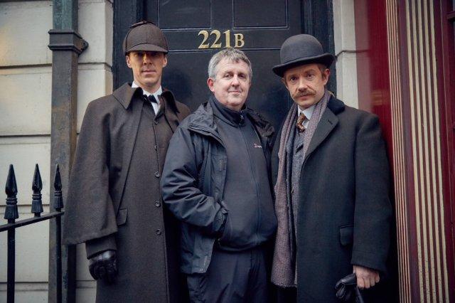 "Behind the scenes of Sherlock, ""The Abominable Bride."" Left to right: Benedict Cumberbatch (Sherlock Holmes), Douglas Mackinnon, Martin Freeman (Dr. John Watson) Photo by Robert Viglasky"